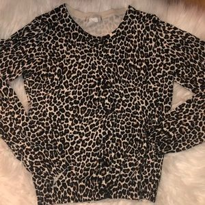 Cheetah print cardigan with black buttons.